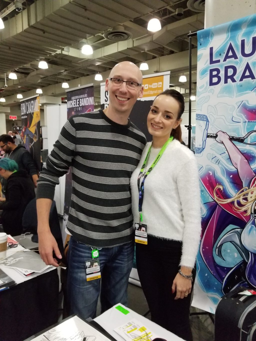 artist laura braga with trevor mueller at new york comic con 2018