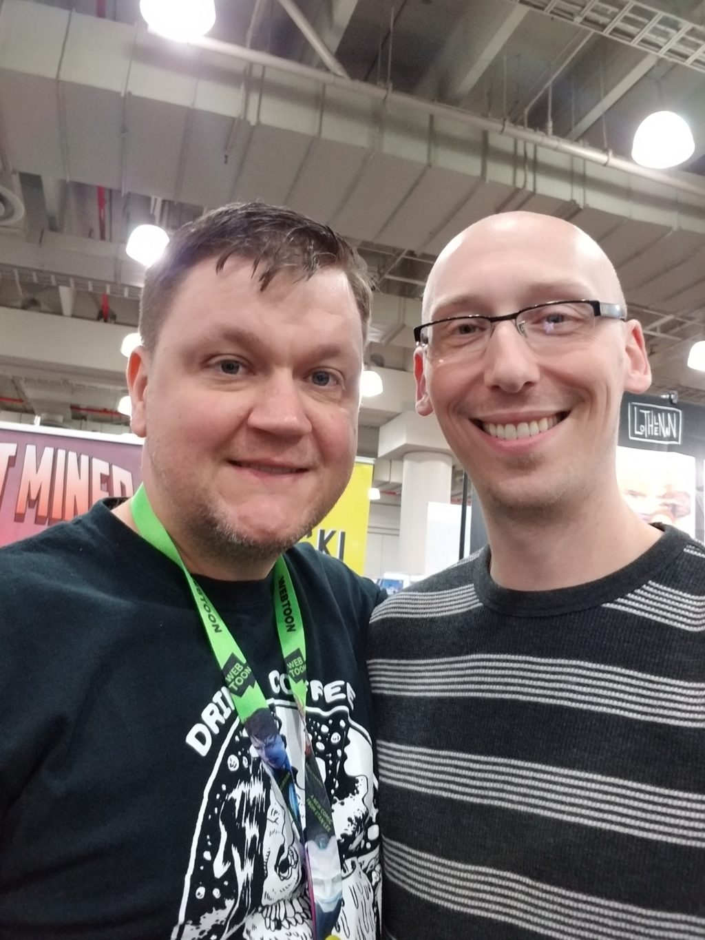 writer eric palicki and trevor mueller in artist alley at nycc 2018