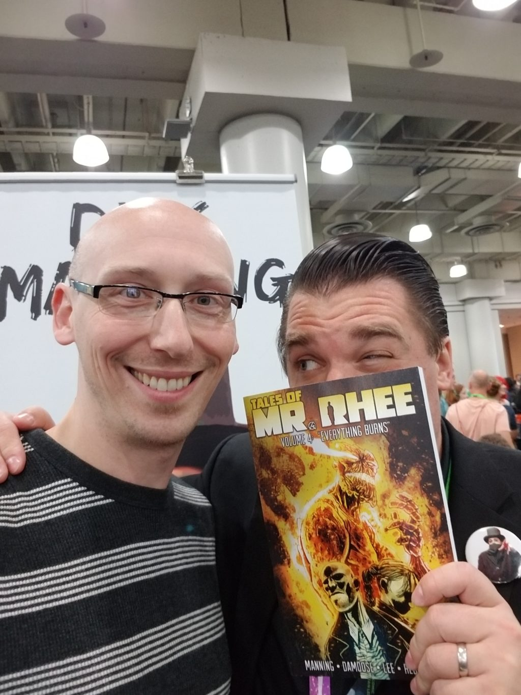 writer dirk manning with trevor mueller in artist alley nycc 2018
