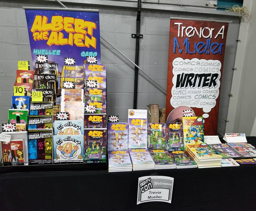 trevor mueller artist alley table mighty con milwaukee 2019