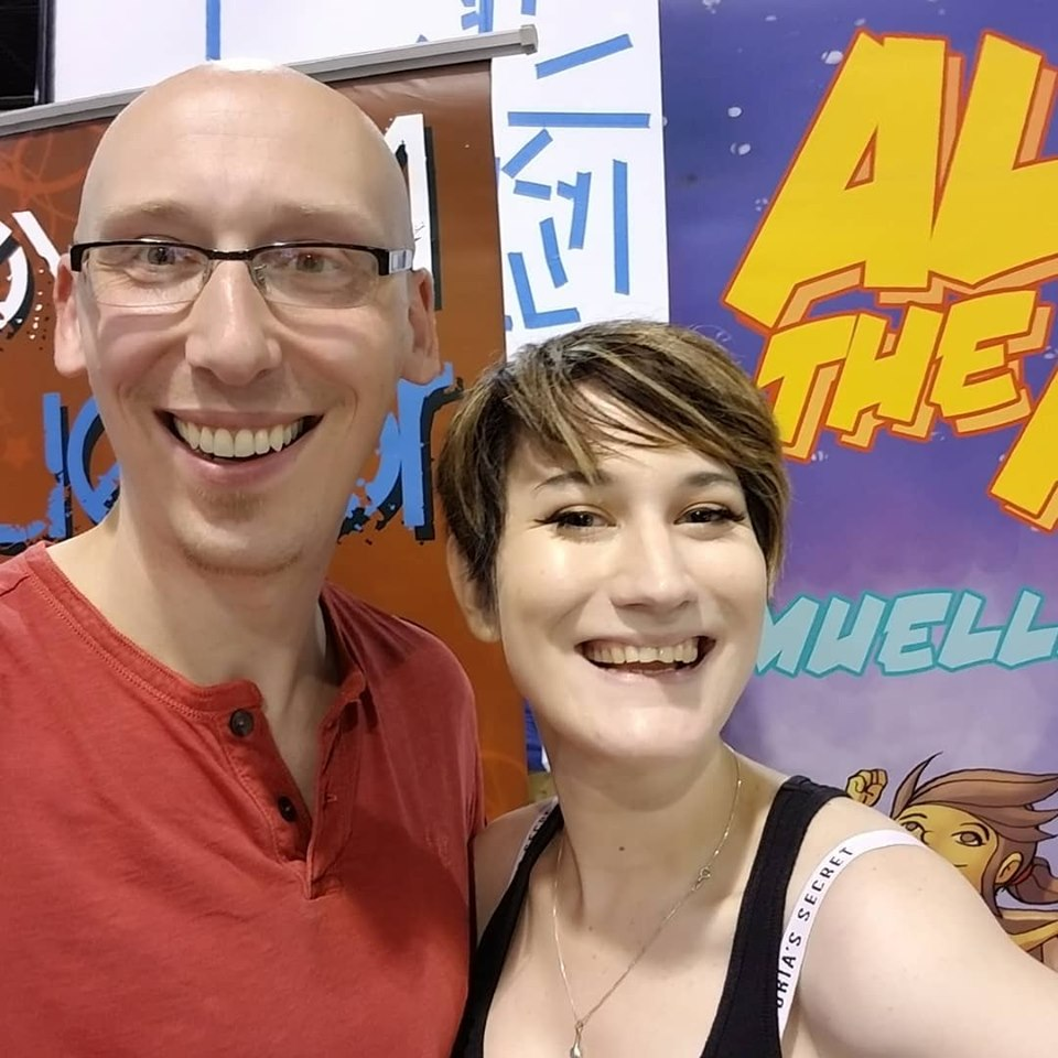 Comic writer and convention guest Trevor Mueller and volunteer Nikita Rauba at Anime Midwest 2019 day 3