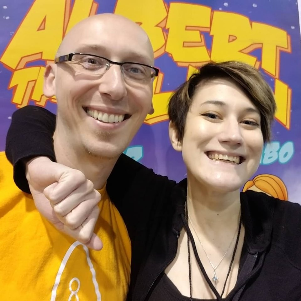Comic writer and guest Trevor Mueller and volunteer Nikita Rauba at Anime Midwest 2019